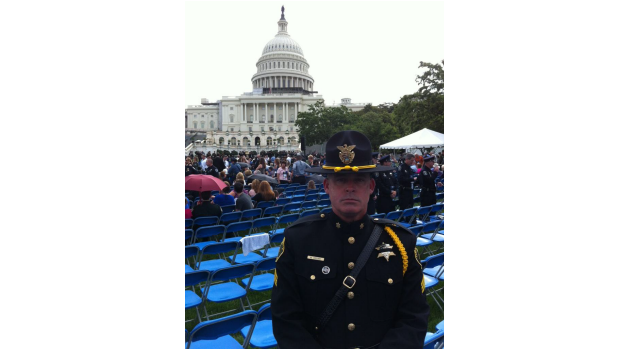 Honor Guard member standing in front of crowd