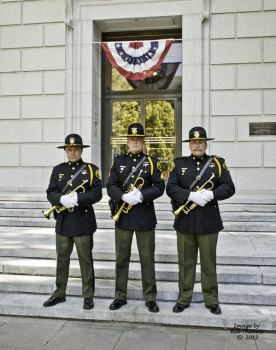 3 Honor Guard members holding trumpets