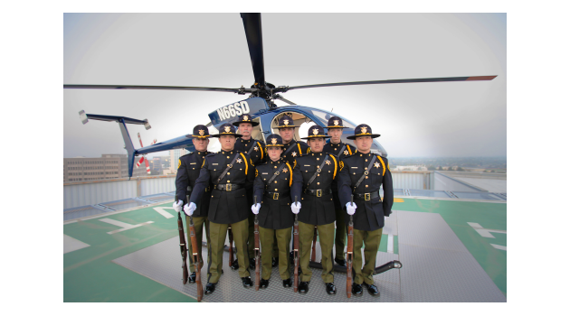 Honor Guard members in front of helicopter